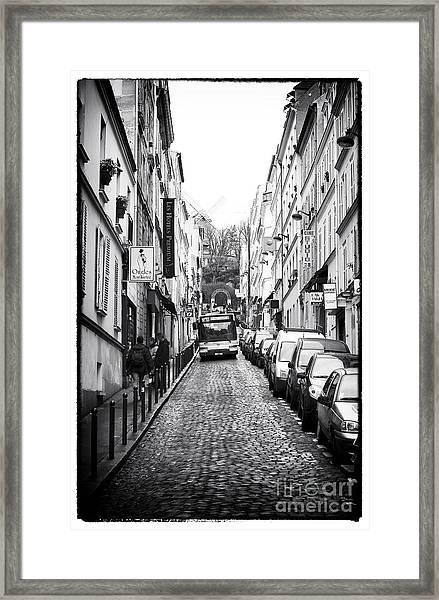 Autobus En Bas De La Rue Framed Print by John Rizzuto