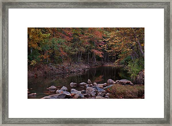 Autumn Leaves Reflecting In The Stream Framed Print