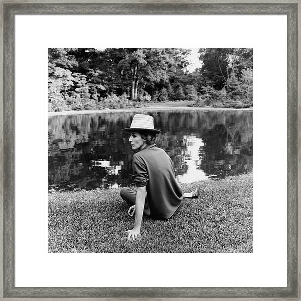 Babe Paley Sitting By A Pond Framed Print