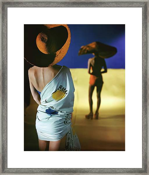Back View Of Two Models Wearing Sarongs Framed Print by Serge Balkin