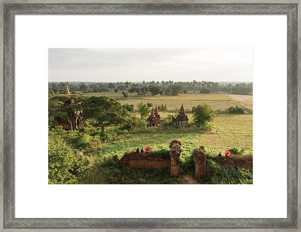 Bagan, Buddhist Monks Sitting Amongst Framed Print