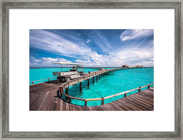Baggy On The Jetty Over The Blue Lagoon Framed Print