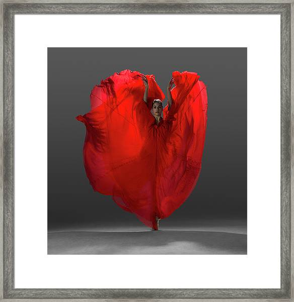 Ballerina On Pointe With Red Dress Framed Print