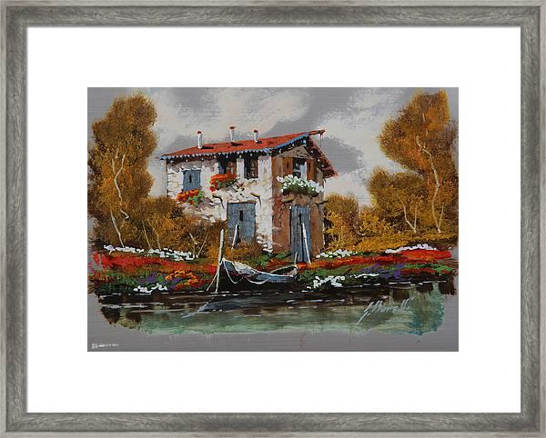 Barca Al Molo Framed Print
