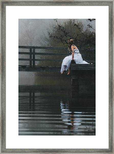 Barefoot Bride In White Wedding Dress Sitting On A Jetty At A La Framed Print by Leander Nardin