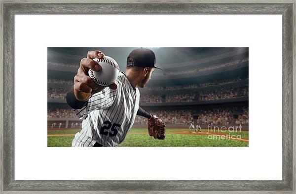 Baseball Player Throws The Ball On Framed Print