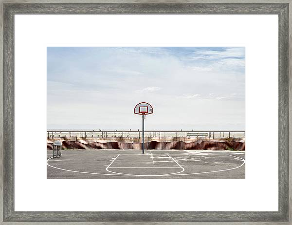 Basketball Court Against Cloudy Sky Framed Print
