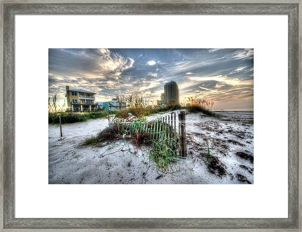 Beach And Buildings Framed Print