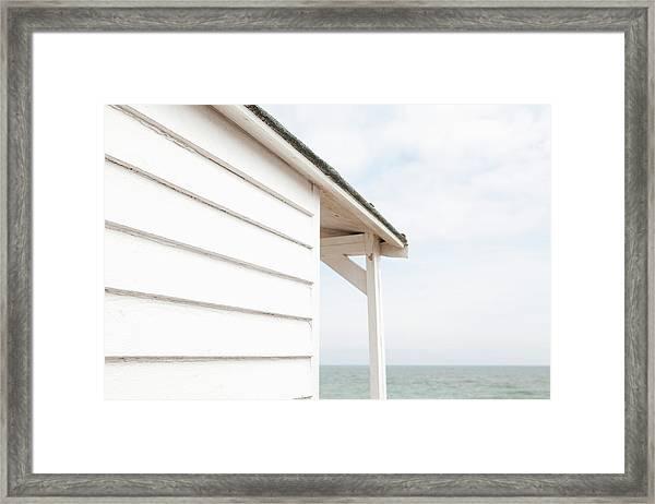 Beach Hut And The Sea Framed Print