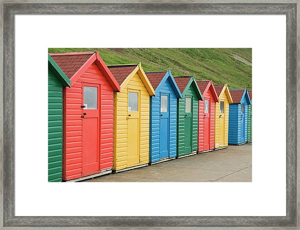 Beach Huts At Whitby Framed Print