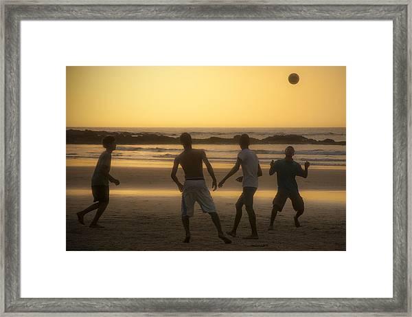 Beach Soccer At Sunset Framed Print