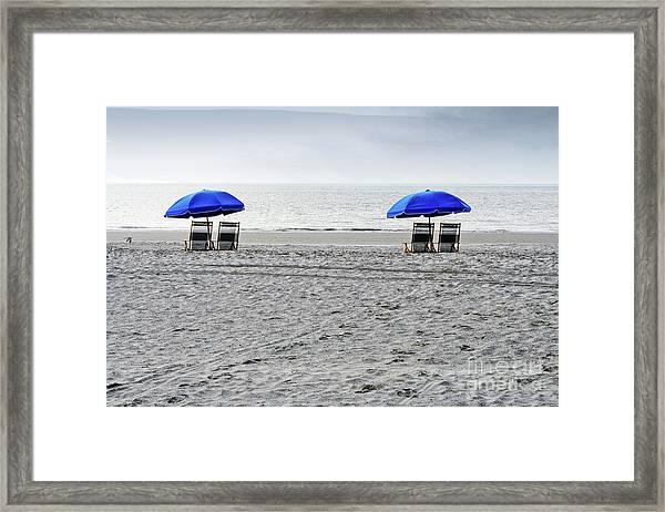 Beach Umbrellas On A Cloudy Day Framed Print