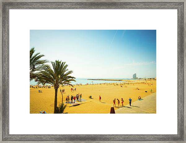 Beach With Parasol In Barcelona, Spain Framed Print