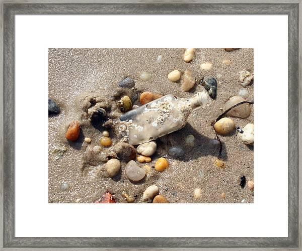 Beached Bottle Framed Print