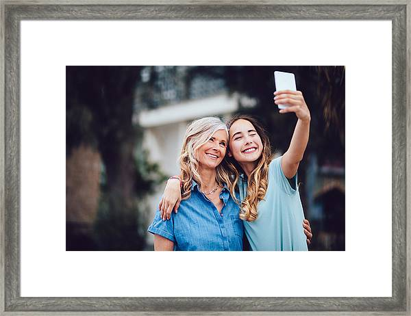 Beautiful Mature Mother And Adult Daughter Taking Selfies Together Framed Print by Wundervisuals