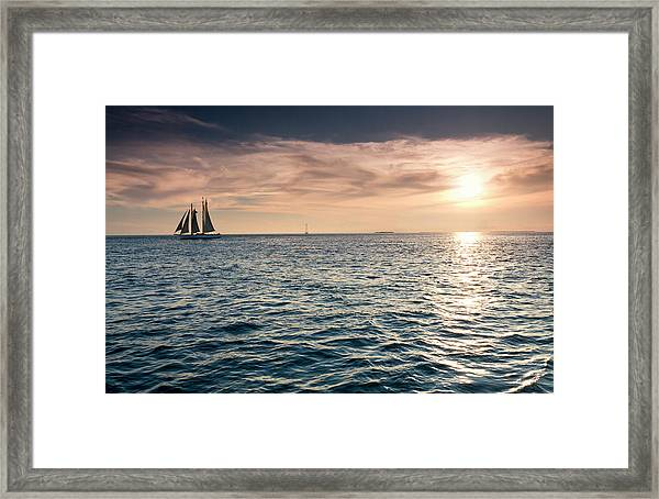 Beautiful Sunset Over The Ocean Waters Framed Print