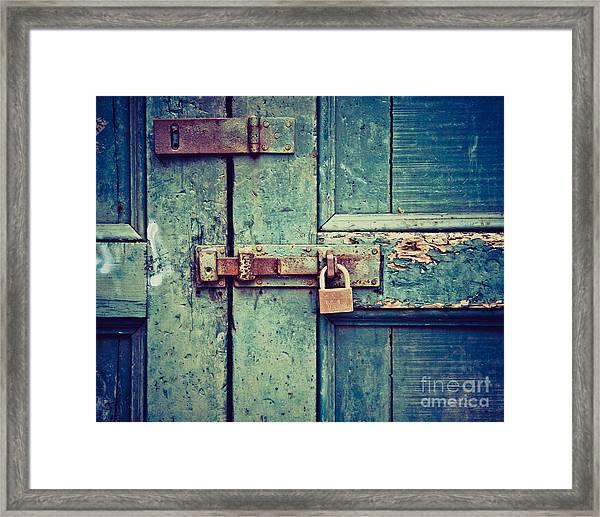 Behind The Blue Door Framed Print