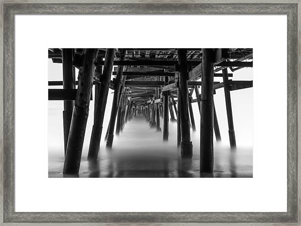Beneath The Pier Framed Print