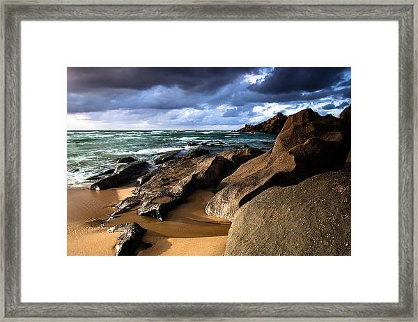 Between Rocks And Water Framed Print