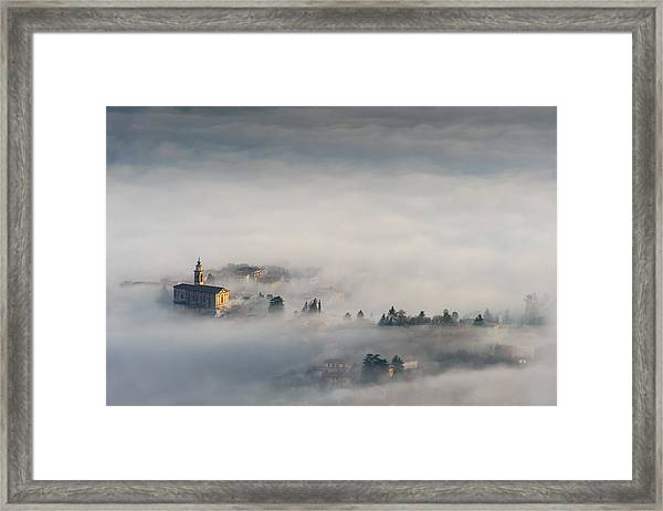 Between The Earth And The Sky Framed Print by Roberto Marini