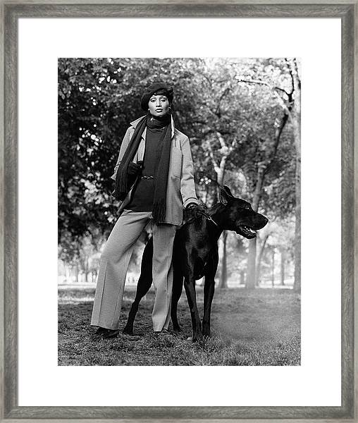 Beverly Johnson With A Dog Framed Print
