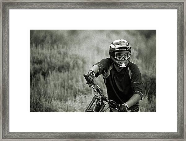 Biker Hikes Up After Hitting Jump Framed Print