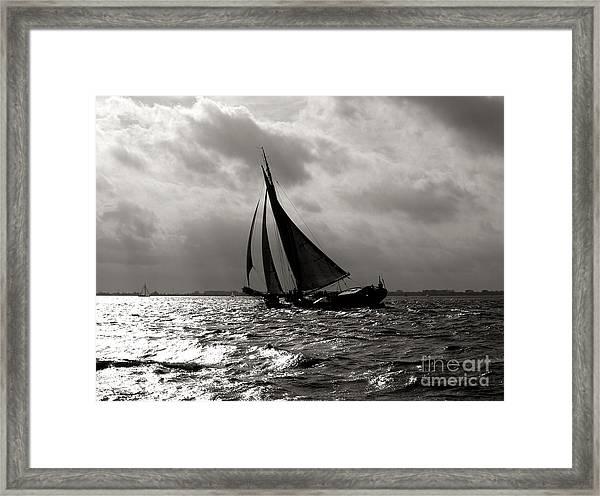 Black Sail Sunset Framed Print