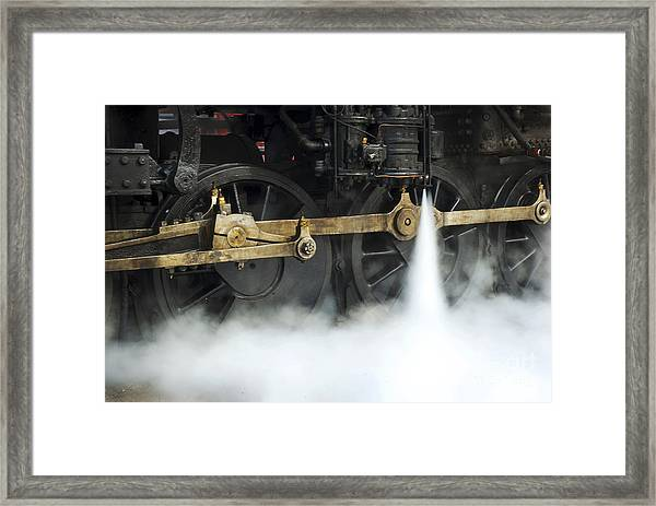 Blowing Of Steam Framed Print