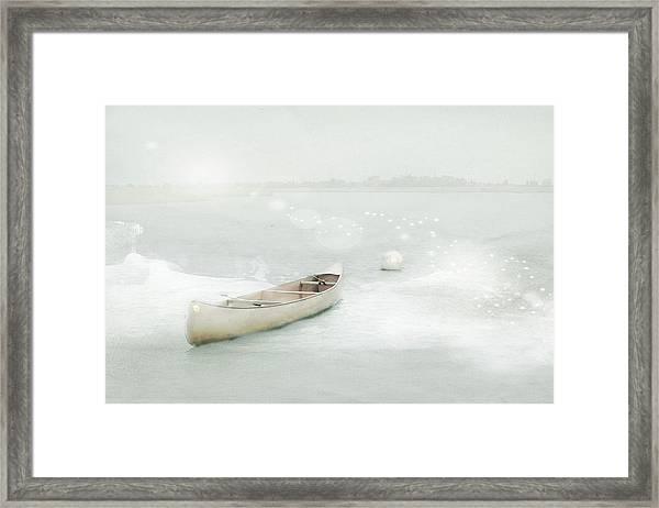 Blue Canoe Framed Print