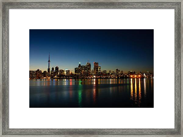 Blue Hour - Toronto's Dazzling Skyline Reflecting In Lake Ontario Framed Print