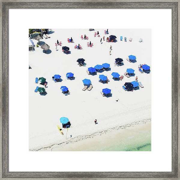 Blue Umbrellas On A Sunny Beach Framed Print by Tommy Clarke