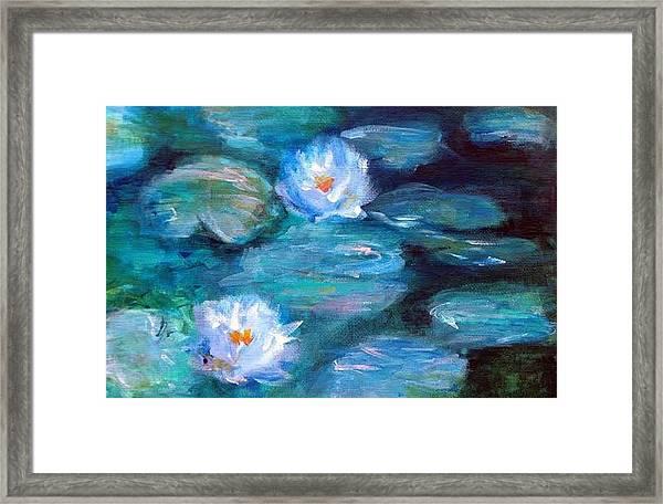 Blue Water Lilies Framed Print