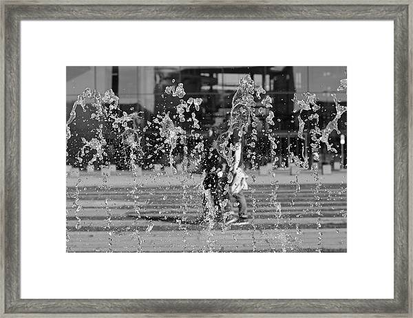Blurred Motion Of Fountain Against Building Framed Print by Aydin Aksakal / EyeEm