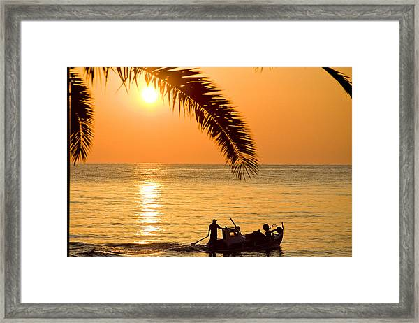 Framed Print featuring the photograph Boat At Sea Sunset Golden Color With Palm by Raimond Klavins