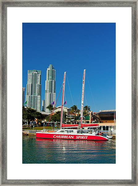 Boat By City Framed Print