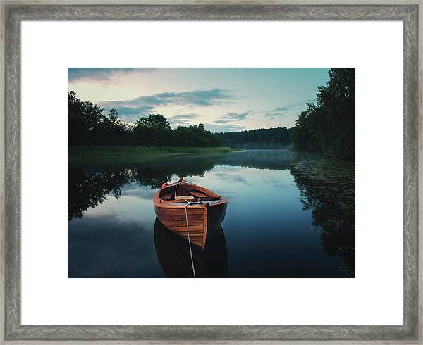 Boat In Fog Framed Print by Christian Lindsten