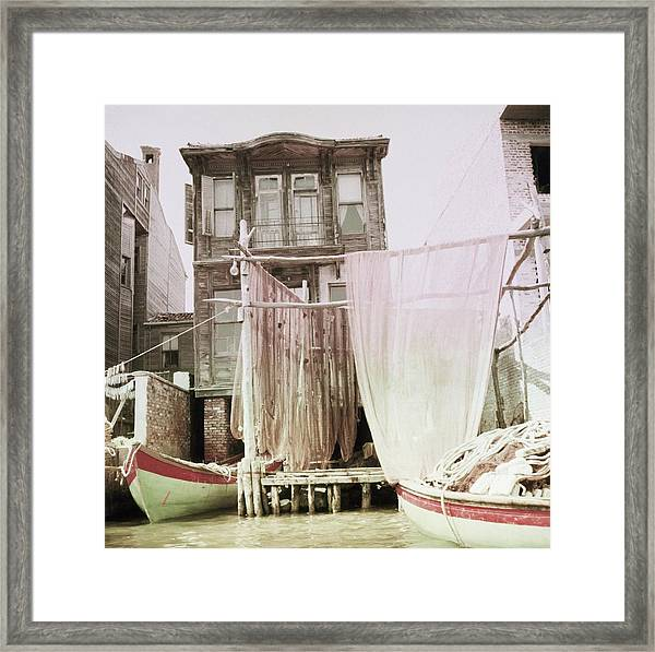 Boats Moored By A House In Turkey Framed Print