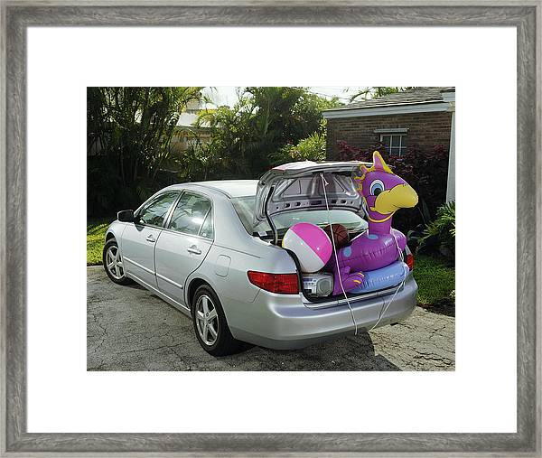 Boot Of Car Packed With Inflatable Toy, Balls And Stereo Framed Print by Baerbel Schmidt