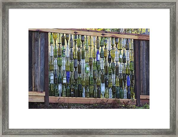 Bottle Fence Framed Print