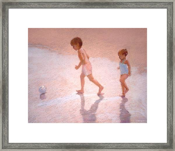 Boy And Girl W/ball Framed Print