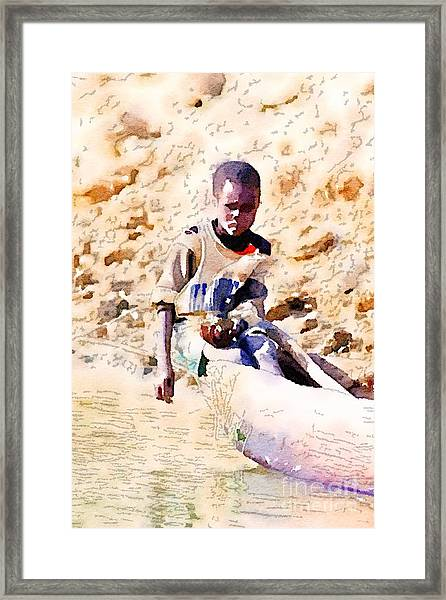 Boy In The Boat Framed Print