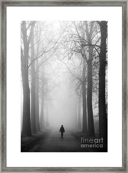 Boy In The Fog Framed Print