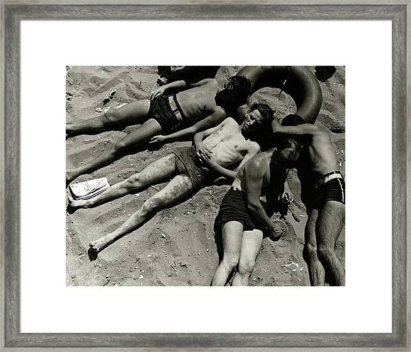 Boys Lying On The Beach At Coney Island In New Framed Print