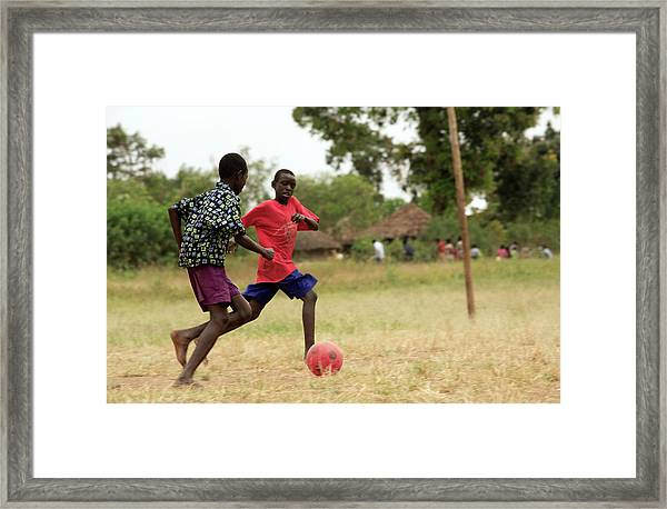 Boys Playing Football Framed Print by Mauro Fermariello/science Photo Library