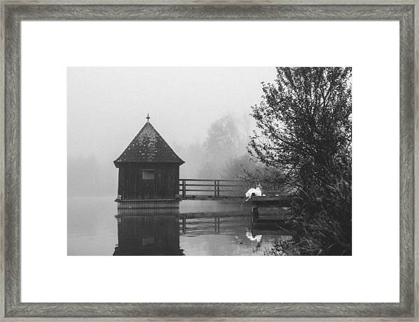 Bride In Foggy Landscape Sitting On A Jetty At A Lake Framed Print by Leander Nardin