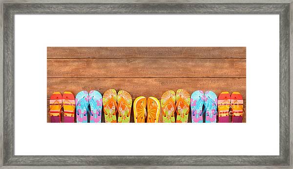 Brightly Colored Flip-flops On Wood  Framed Print