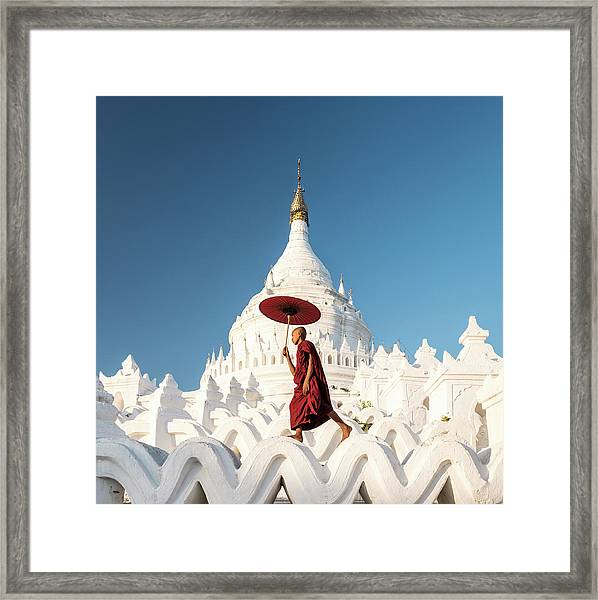 Buddhist Monk Walking Across Arches Of Framed Print