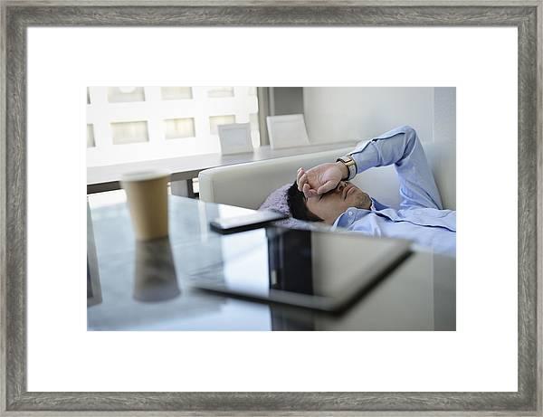 Business Man Sleeping On The Sofa In Office Framed Print by Yagi Studio