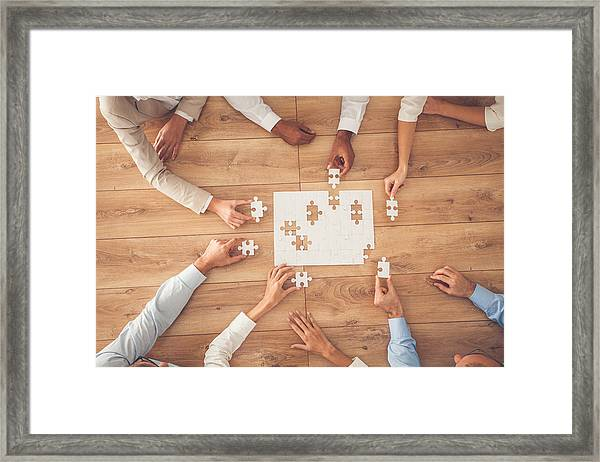 Business People Finding Solution Together At Office Framed Print by Fotostorm