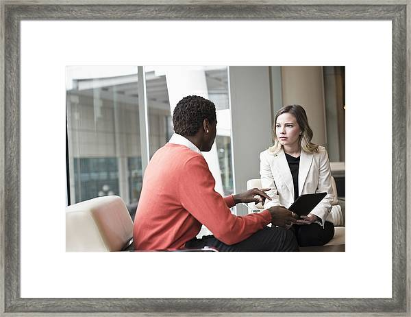 Business People Using Digital Tablet In Office Framed Print by Jetta Productions Inc